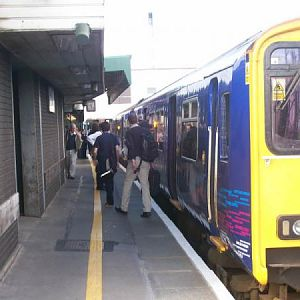 Passengers alight from a train at Temple Meads
