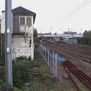 2005, November. Erection of fence between box and railway - fortunately there were points to sidings in front of the box leaving a wide margin where a