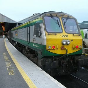 #13: Enterprise power unit 228 awaits departure from the island's largest station, Dublin Connolly.