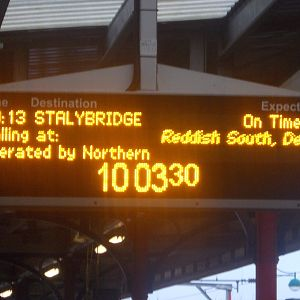 The screen on platform 1 showing that the train would be stopping at Reddish South.