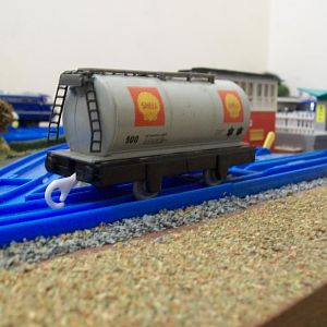 The Hornby tank wagon body is a good match in length and width, for the Plarail chassis, requiring very little work, other than trimming some plastic