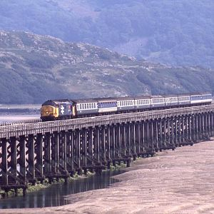 37429 crosses the Mawddach estuary at Barmouth, operating the summer Saturday Euston to Pwllheli service, August 1990.