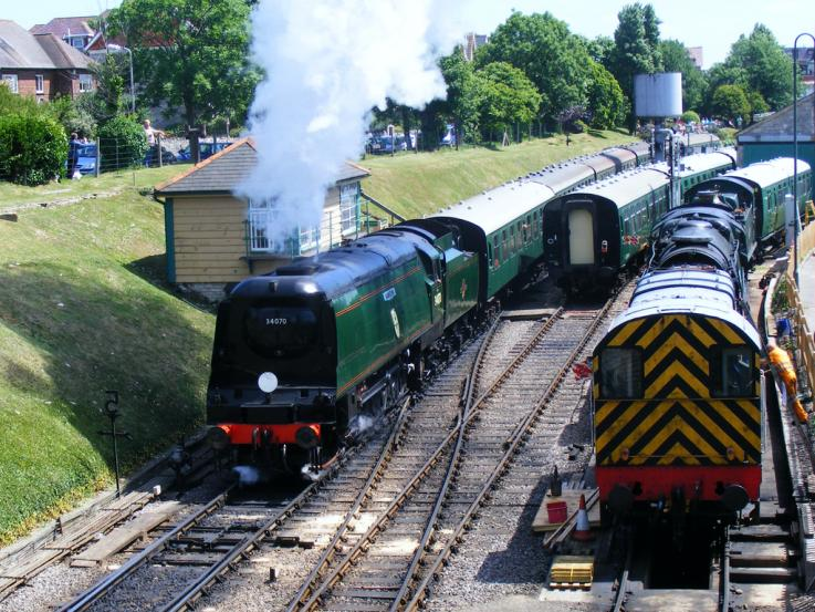 Southern Locomotives Ltd owned Bullied Battle of Britain class Pacific No. 34070 'Manston' steams out of Swanage station with a train for Norden on 16